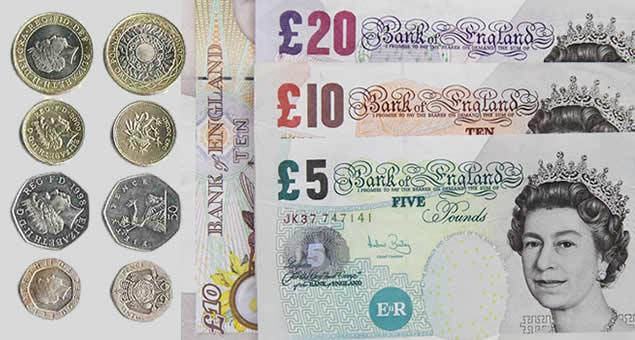 Notas e moedas em libra